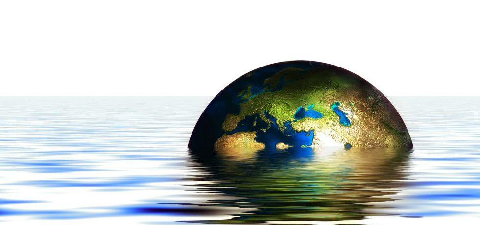 Animerad bild av havsyta där jorden bryter ytan och sticker upp halvvägs